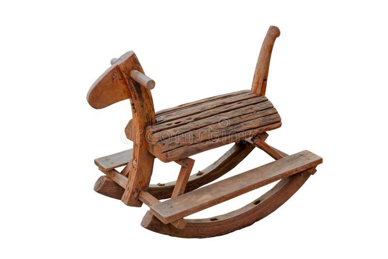 Los niños clásicos de la silla del caballo mecedora del vintage lindo podrían disfrutar del montar a caballo imagen de archivo