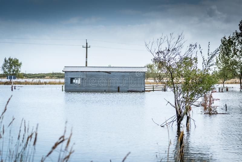 Los niveles de levantamiento del mar causan fooding en zonas costeras fotos de archivo libres de regalías
