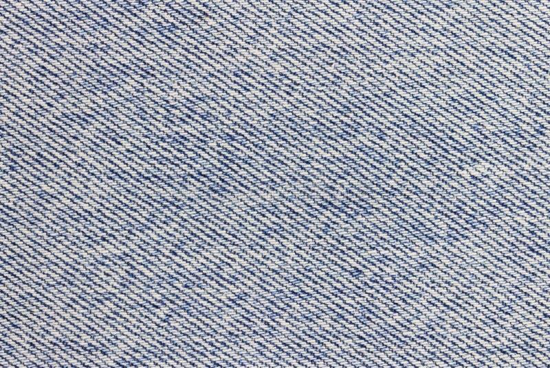 Los nuevos vaqueros o tela azul marino del dril de algodón texturizan el fondo para el diseño imagen de archivo