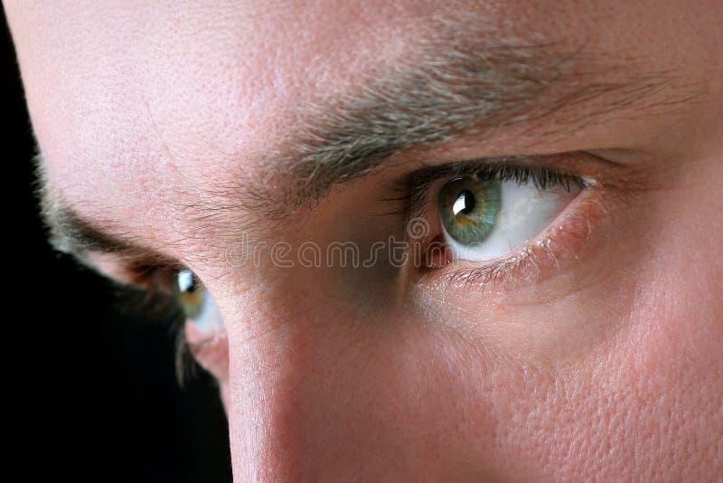 Los ojos del hombre imagenes de archivo