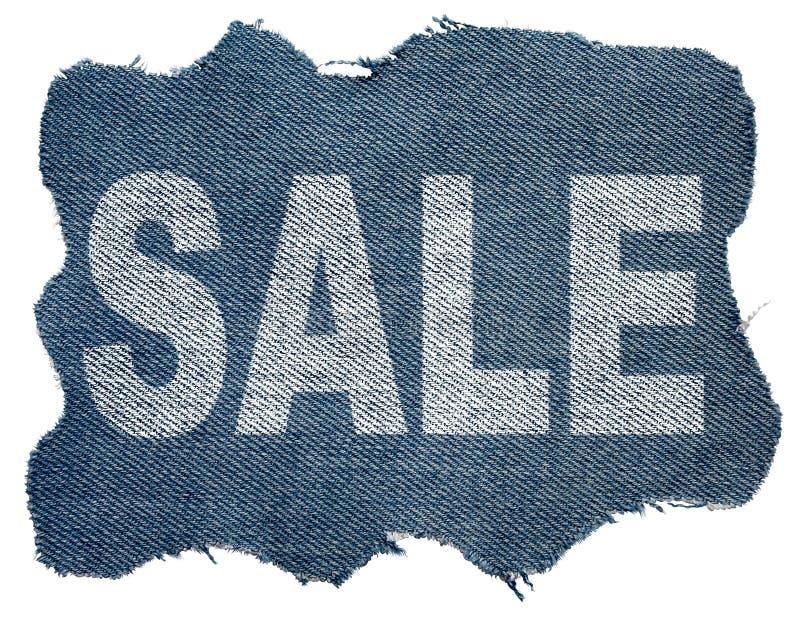 Los pantalones vaqueros etiquetan con venta de la palabra foto de archivo libre de regalías