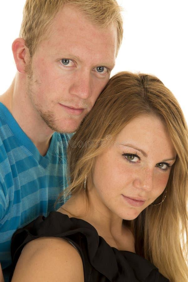 Los pares sirven la mirada cercana de las cabezas azules de la camisa imagen de archivo