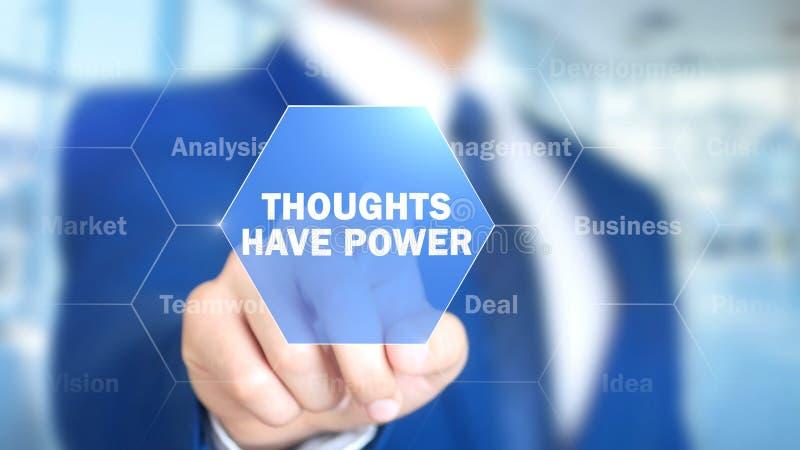 Los pensamientos tienen poder, hombre que trabaja en el interfaz olográfico, pantalla visual foto de archivo libre de regalías