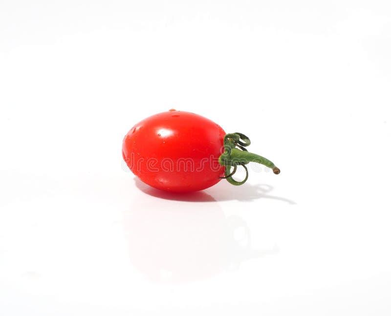 Los pequeños tomates egg el primer con el fondo blanco imagen de archivo libre de regalías