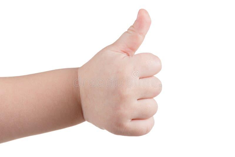 Los pulgares de la aprobación para arriba les gusta la muestra, gesto de mano caucásico del niño aislada sobre blanco imagen de archivo