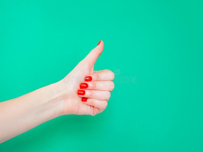 Los pulgares encima de la muestra Como muestra de la mano Utilizado cuando usted quiere demostrar que usted tiene gusto algo o de fotografía de archivo