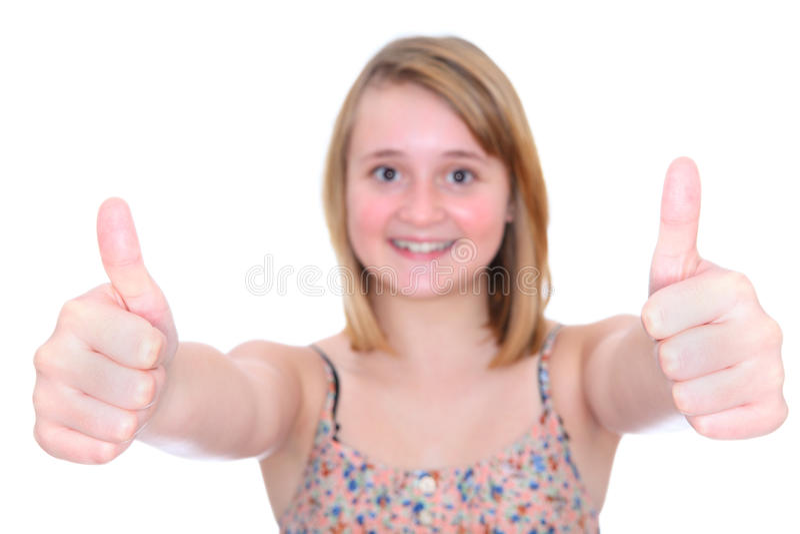 Los pulgares suben a la muchacha adolescente imagenes de archivo