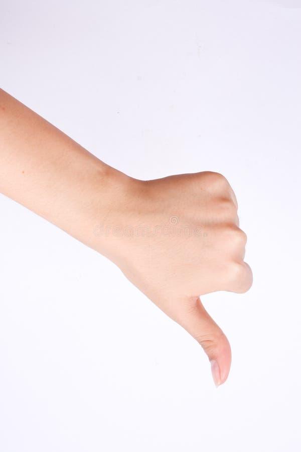 Los símbolos de la mano del finger aislaron la mano del concepto que mostraba los pulgares abajo y el mún botón de la aversión en fotos de archivo