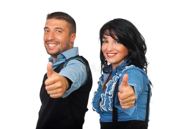 Los socios comerciales felices dan los pulgares imagenes de archivo