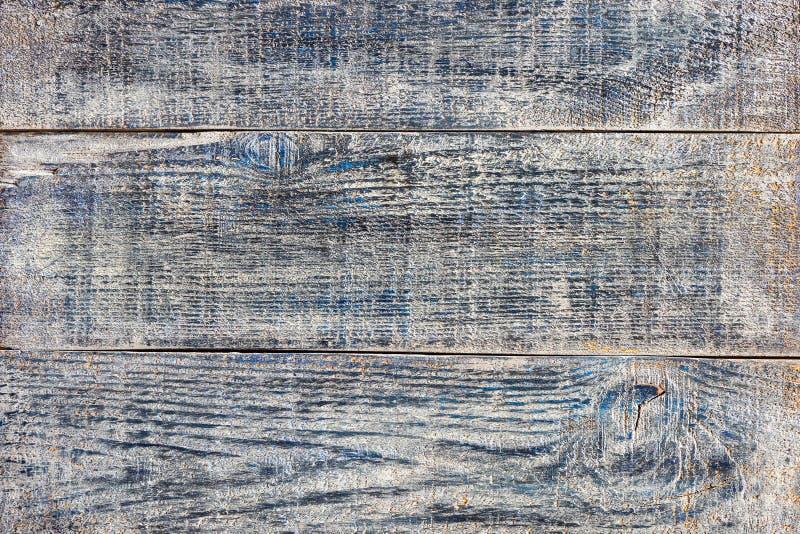 Los tablones de madera viejos del dril de algodón de la pintura azul gris del efecto pintaron textura lamentable del fondo foto de archivo