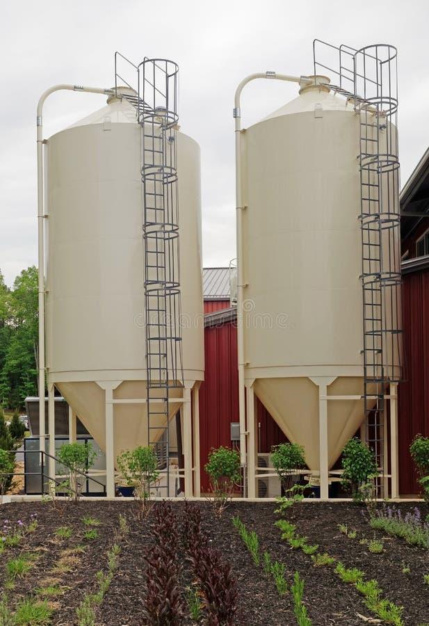 Los tanques de la cervecería con Herb Garden foto de archivo libre de regalías