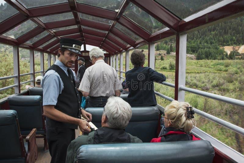 Los tickes de las tomas del guardafrenos en Durango y el ferrocarril del indicador estrecho de Silverton que ofrecen el tren del  imagen de archivo libre de regalías