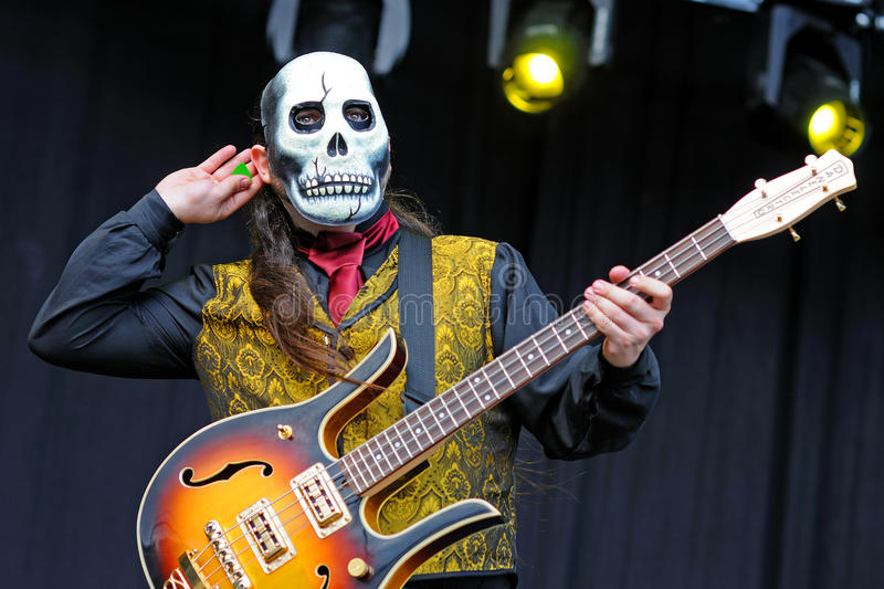 Los Tiki Phantoms, Spanish band which performs their concerts disguised with skull masks at FIB Festival. BENICASSIM, SPAIN - JULY 12: Los Tiki Phantoms, Spanish stock photo