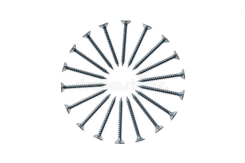 Los tornillos de metal arreglaron en círculo en el fondo blanco fotos de archivo