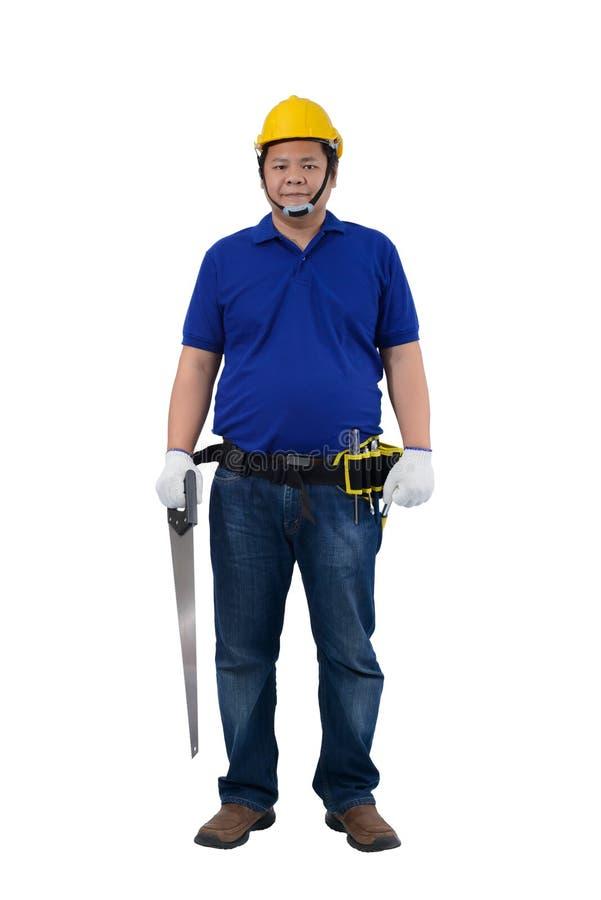 Los trabajadores del hombre de la construcción en la camisa azul con los guantes protectores, casco con la tenencia de la mano de imágenes de archivo libres de regalías