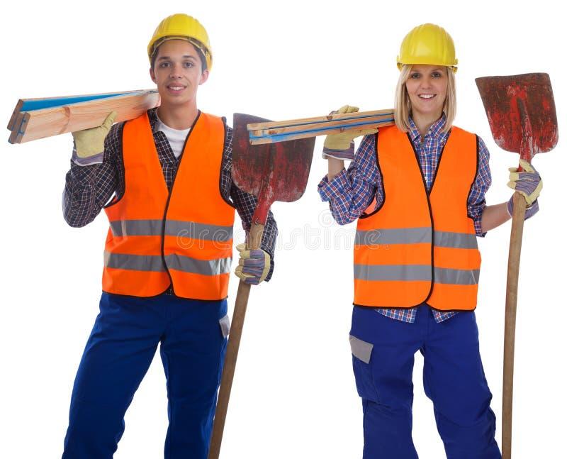 Los trabajadores jovenes del trabajador de construcción sirven trabajo de la mujer aislados imagenes de archivo