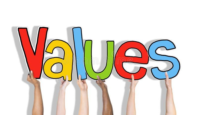 Los valores redactan y pared de ladrillo en el fondo imágenes de archivo libres de regalías