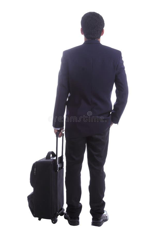 Los viajeros de negocios que colocan para la espera algo, incluyen clippi foto de archivo libre de regalías