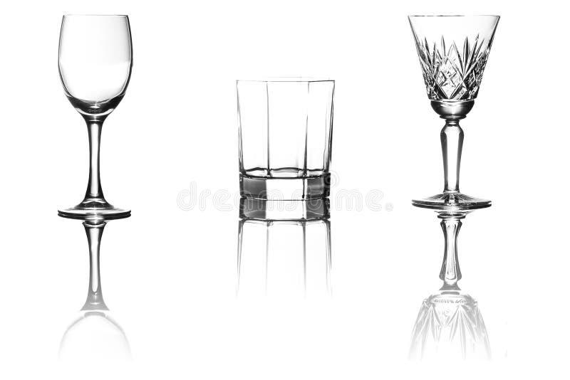 Los vidrios del vino y del whisky vacian fotografía de archivo libre de regalías