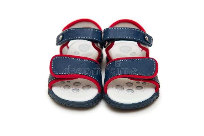 Los zapatos de bebé aislados en el fondo blanco foto de archivo libre de regalías