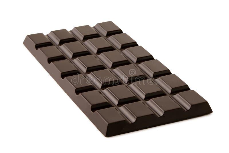 Losa entera del chocolate oscuro aislada en blanco fotos de archivo