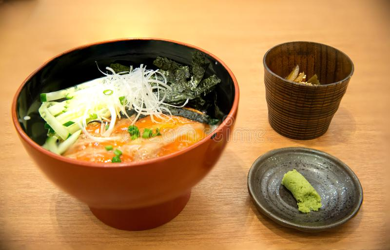 lose up fresh salmon filler and egg topped on japanese rice in white bowl stock photo