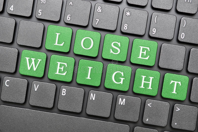 Lose weight key on keyboard royalty free stock image