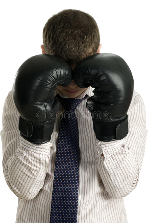 Loser businessman covers his face boxing gloves royalty free stock images