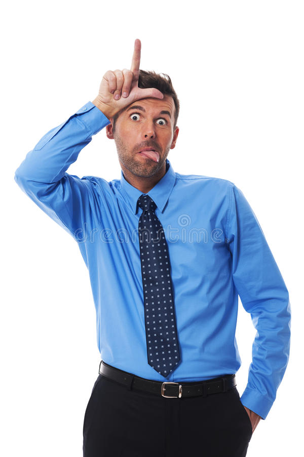 Loser!. Man showing tongue and loser sign royalty free stock photography