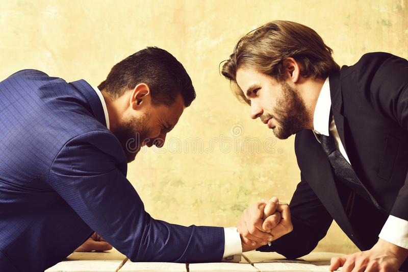 Loser man shouting, arm wrestling defeat and victory of businessman. Loser men shouting, arm wrestling defeat and victory of businessman in suit royalty free stock image