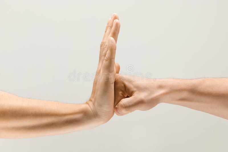 Loseup shot of male hands isolated on grey studio background. Leave your negative. loseup shot of male hands demonstrating stop sign isolated on grey studio royalty free stock photos