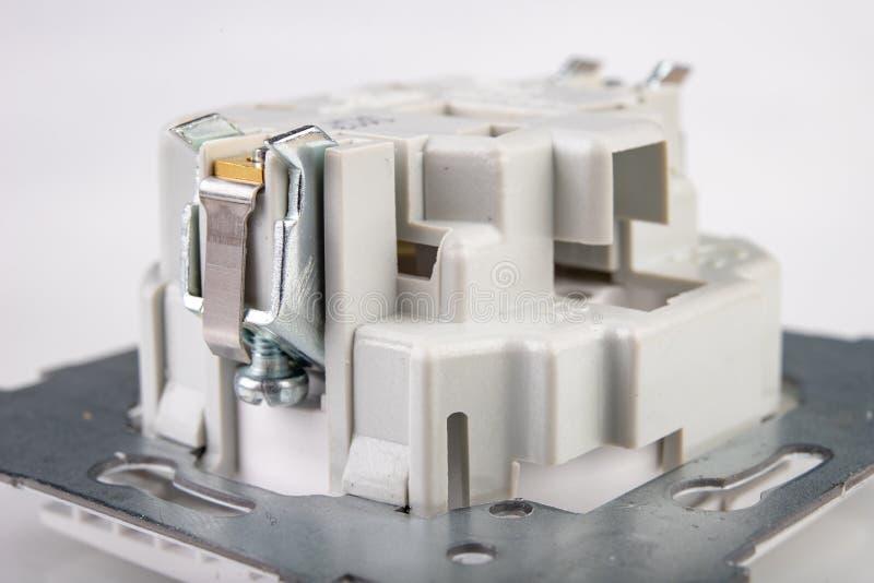 Losgeschroefte elektrocontactdoos Toebehoren en componenten voor de elektricien nodig voor assemblage in een losgemaakt huis royalty-vrije stock fotografie