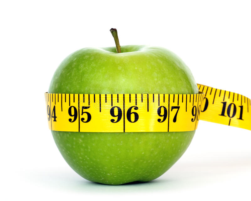 Losing weight. Green apple with centimeter isolated on white background
