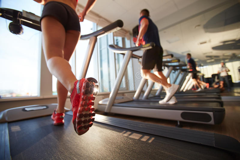 Losing weight on treadmill royalty free stock photo