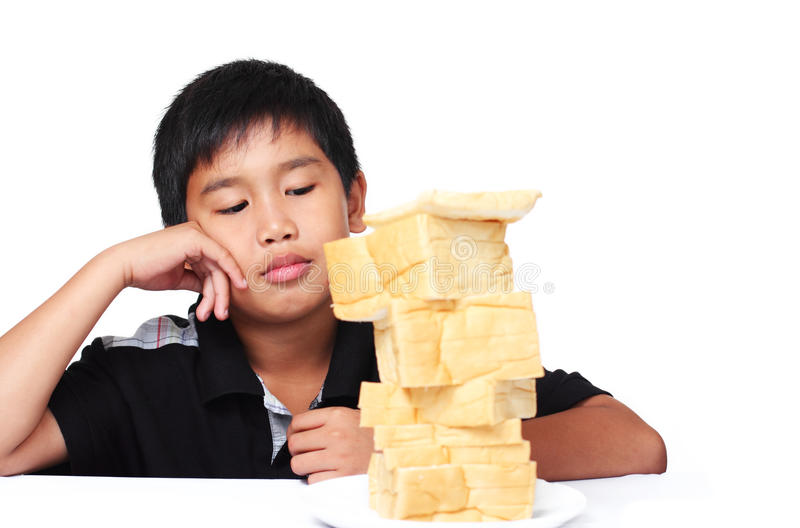 Loss of appetite. Image of a boy with no appetite royalty free stock photo
