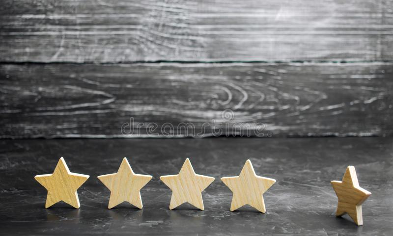 The loss of the fifth star of the restaurant or hotel. The fall in rating and recognition. Deterioration in service quality. Restaurant hotel overview. Bad royalty free stock photos