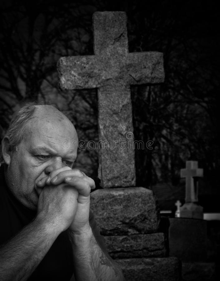 Loss, Grieving. An older man in deep sorrow and suffering due to the passing of someone close