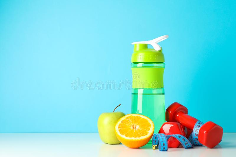 Loss weight accessories on white table. Against blue background stock image