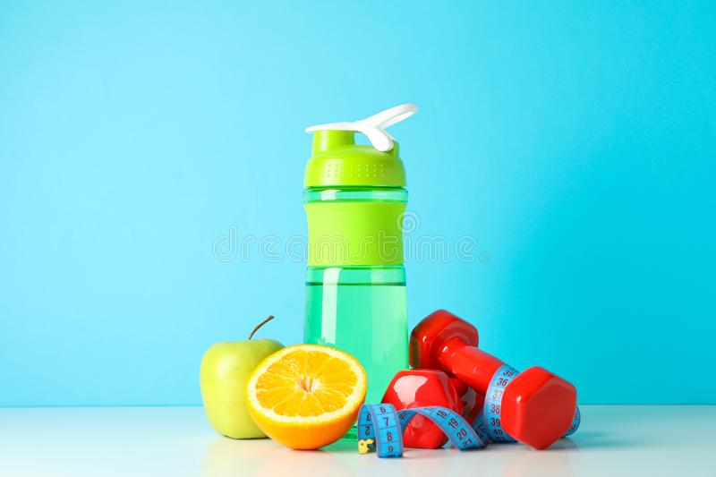 Loss weight accessories on white table. Against blue background royalty free stock photo