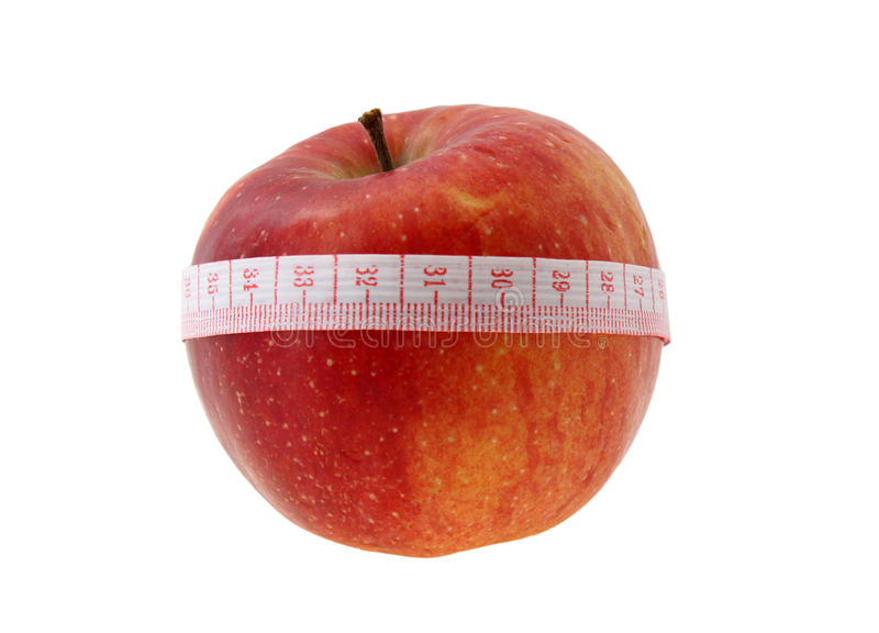 Loss weight food. Red apple with meter over white stock photography