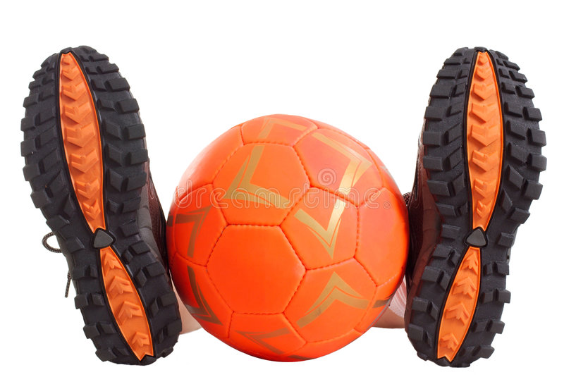 Lost. Sports footwear and orange ball. The white background isolated stock photo