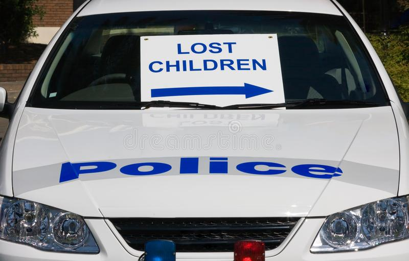 Lost Children sign. A police car with a lost children sign stock images