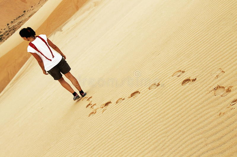 Lost in the desert. A girl lost in the desert stock photo