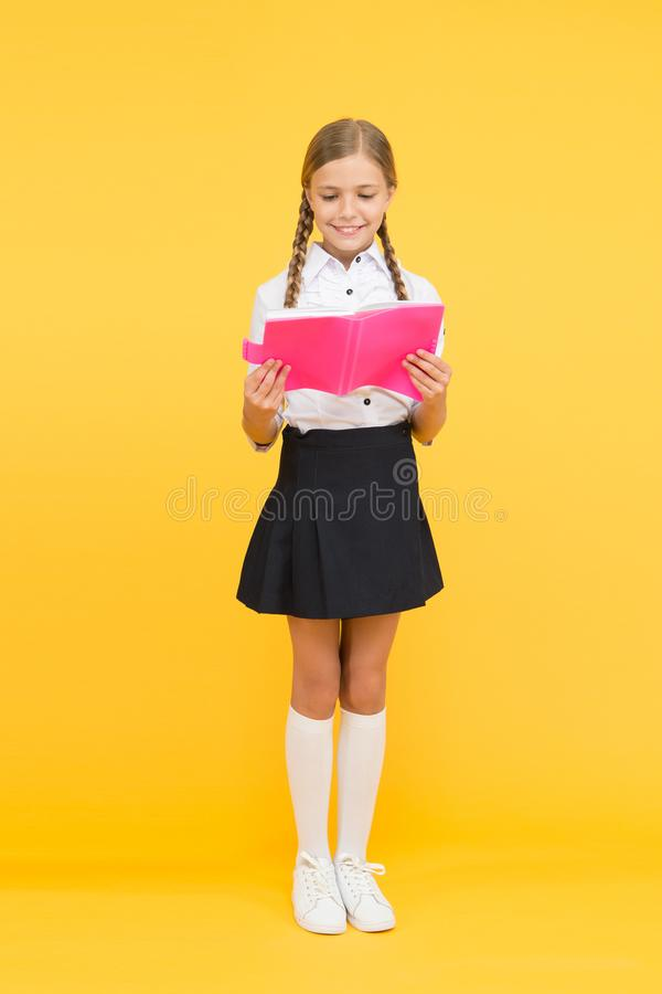 Lost in fairytale. happy girl study hard with notebook. back to school. Pupil at book store or library. reading and. Writing. literature lesson. childrens stock photography