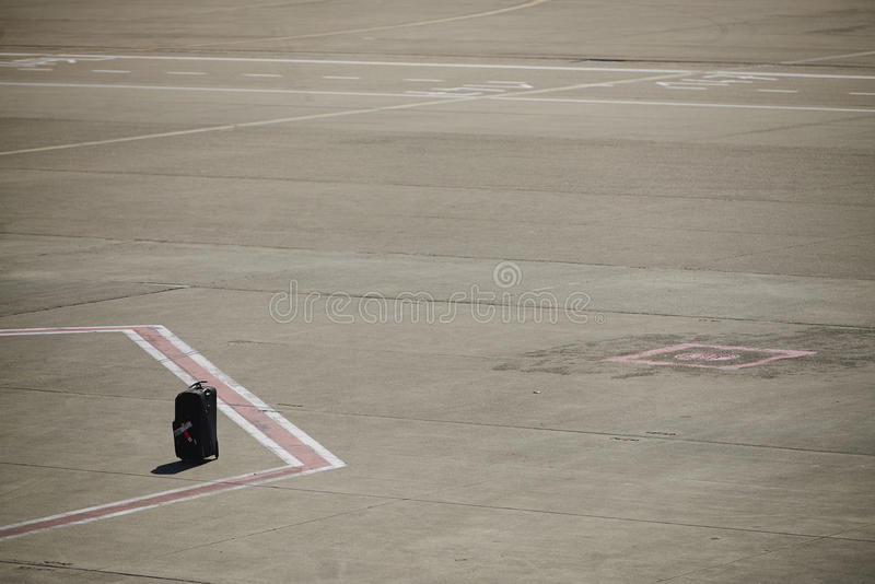 Lost luggage on an airport runway stock images