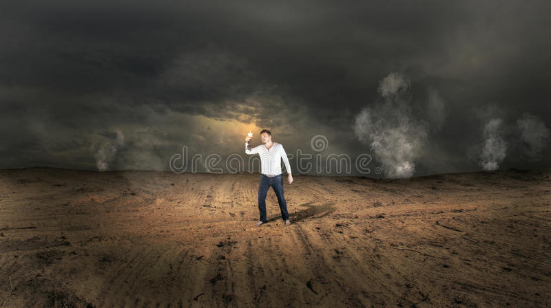 Lost Man in Strange Land. Lost Man with Candle in Strange Land stock image