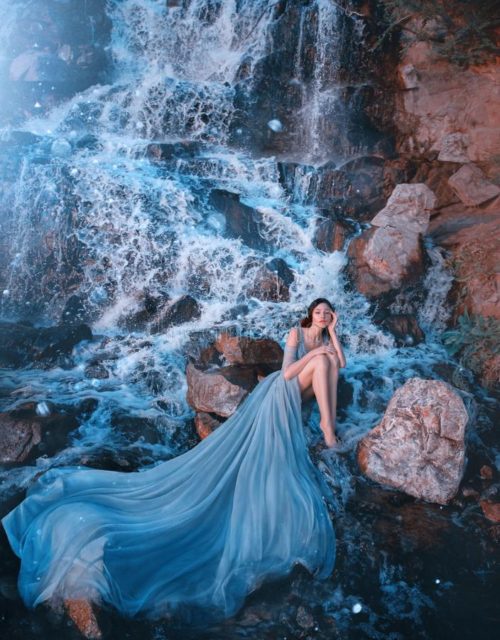 Free Lost Princess Sitting On Wet Stones Near Gorgeous High Waterfall Royalty Free Stock Photos - 155959138