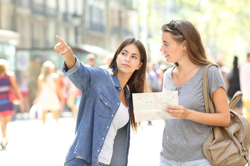 Lost tourist asking for help from a pedestrian. In the street royalty free stock photo