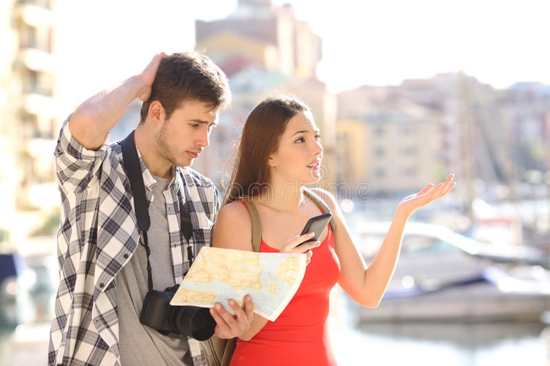 Lost tourists searching travel location stock photos