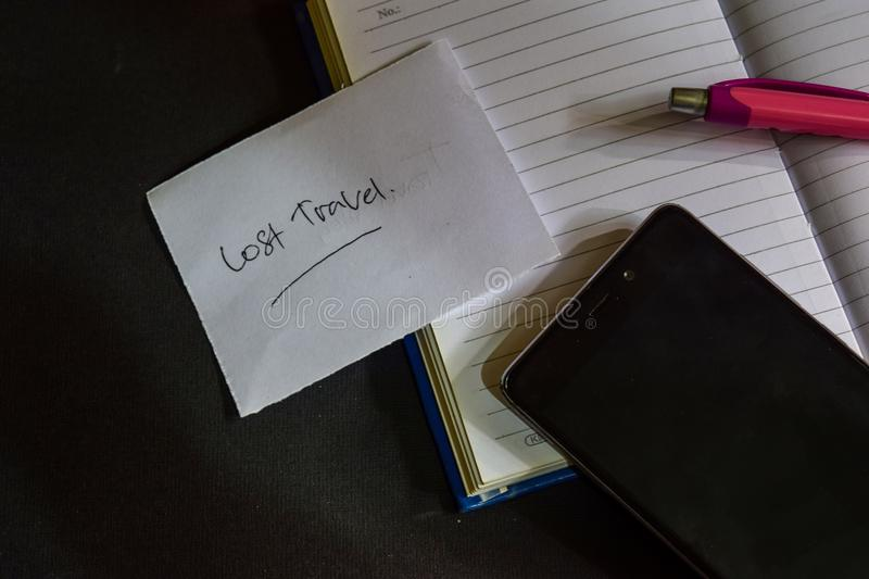 Lost Travel word written on paper. Lost Travel text on workbook, Black background concept stock image